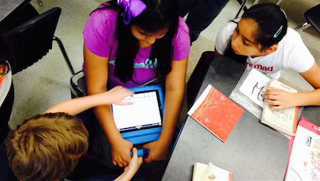 Figure 5. Students Using iPad During Literature Discussion