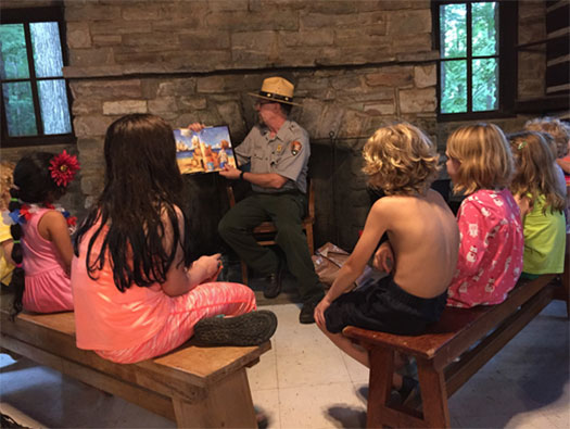 Park Ranger reading aloud