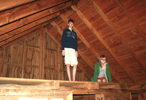 Avery and Breece in the loft at The Little House Wayside