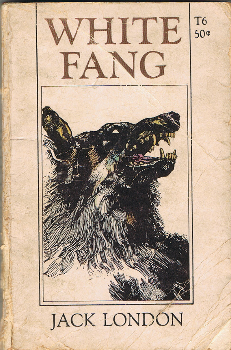 Black and white illustration of dog on old edition of White Fang