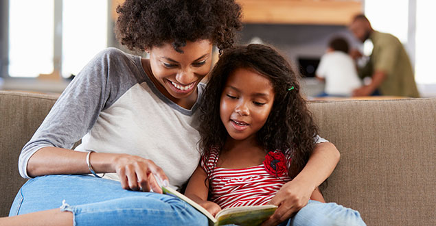 mother and child reading together and practicing decoding