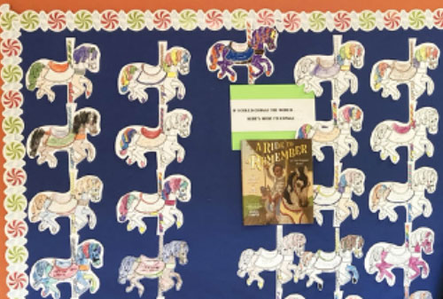 bulletin board display of carousel horses with students' messages