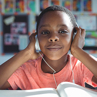 African American elementary school student with headphones