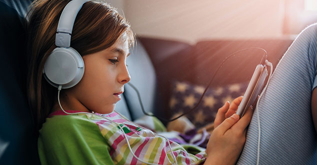 young girl listening to audiobook on phone