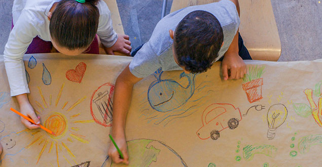 Elementary students drawing a map together