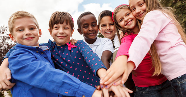 Multiracial group of elementary children holding hands