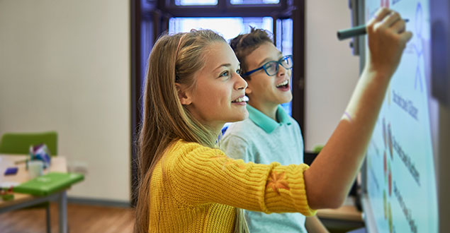 two young adults using a smartboard