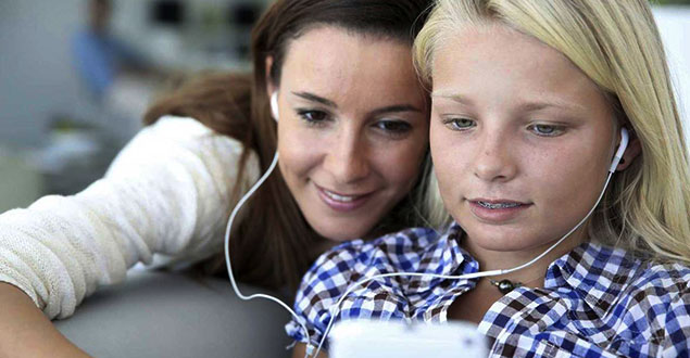 mother and child using ear buds to listen to text