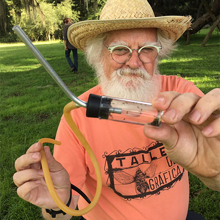 Children's science picture book author Kevin McCloskey collecting ants in a glass tube
