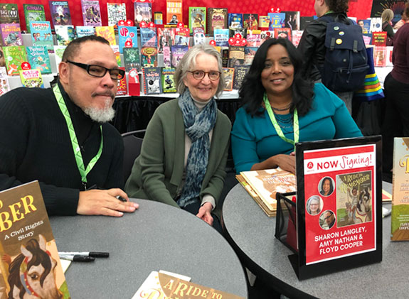 Ride to Remember authors Sharon Langley and Amy Nathan and illustrator Floyd Cooper at a book signing event