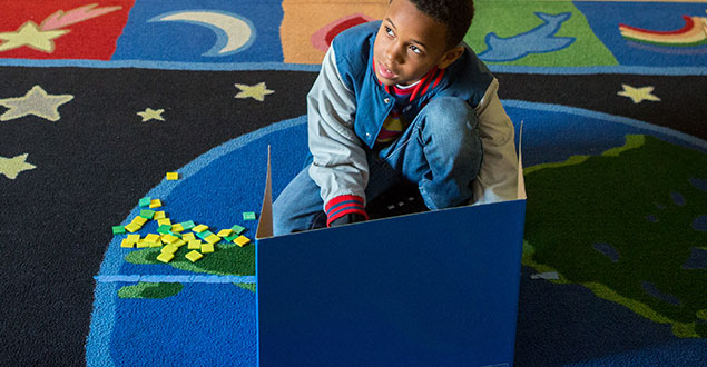 Elementary student working in sensory-friendly classroom space