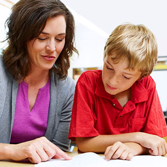 Teacher assessing student's reading skills