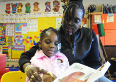 Parent Althea Slayden practices the reading strategies she's learned on her daughter, Nygeria